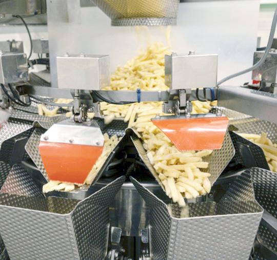 写真:計量精度や作業効率が要求される計量物の専用充填機